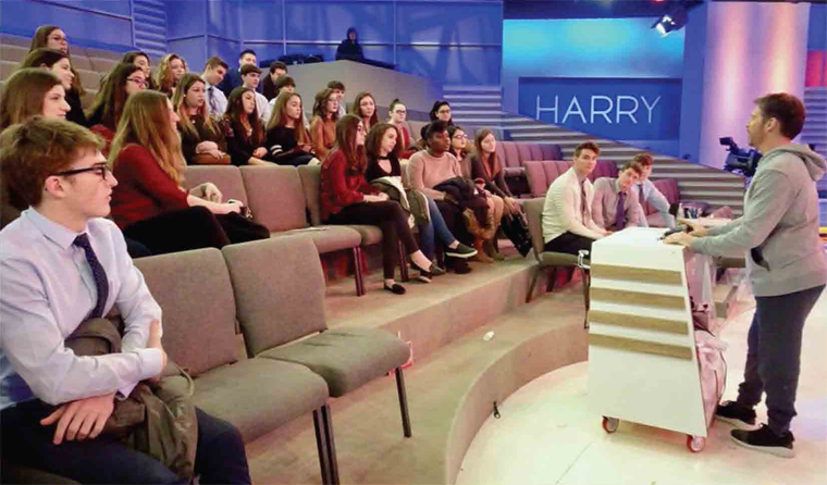 Monsignor	Farrell	and	St.	Joseph	Hill	High	School	students	listen	to	Harry	