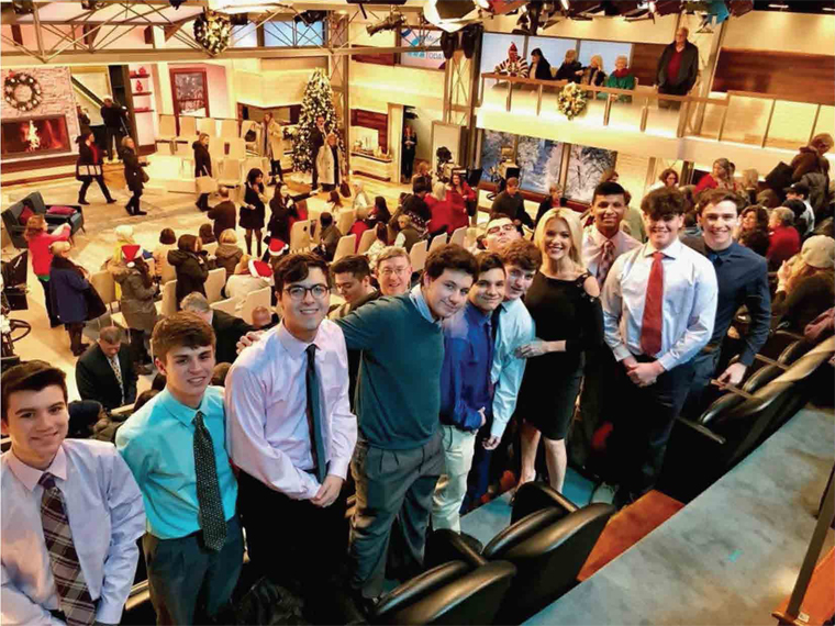 Megyn	Kelly,	fourth	from	right	and	Brother	Paul	Hannon,	join	students	from	