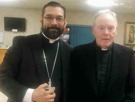 Bishop Flores (left) and Brother McCormack.