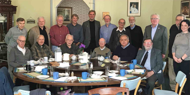 Seated	(l	to	r)	Br.	Harry	French,	Fr.	Bill	Brown,	SJ,	Br.	Bert	Darcy,	Br.	Raph	Bellows,	Mr.	Tom	