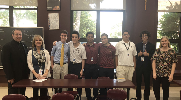 Jessica (far right) poses with student members of Iona Prep's Human Rights Club, ERCBNA Province Leader, Br. Kevin Griffith (far left) and Iona Prep Instructor and Human Rights Club Co-Moderator, Christine Chana (2nd from left).