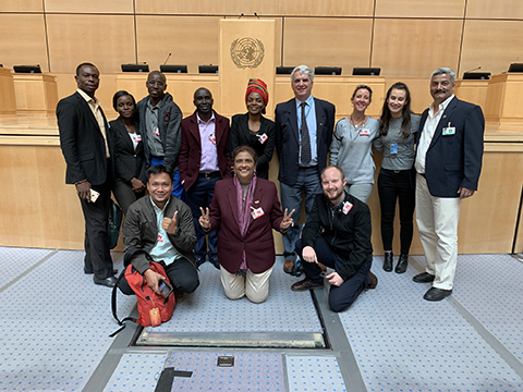 Mia posing with other ERCB Network members inside the UN after the Universal Periodic Review.