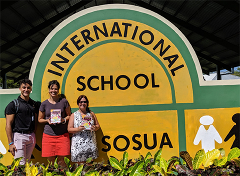 Angelo visits with staff members at the International School of Sosua, one of the many locations where he distributed copies of the book.