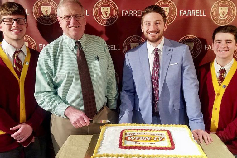 Farrell Principal Lawrence Musanti and Michael Leavy with Matthew Sullivan, left, and Matthew Giacobbe, right.