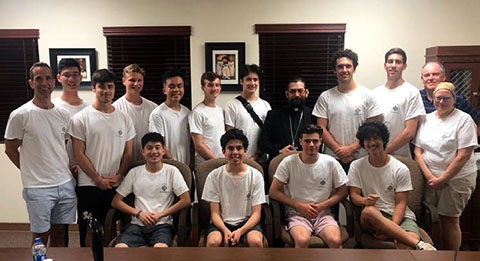 Students from Vancouver College pose with Brownsville Bishop Daniel Flores (right-center) during the third week of the 2019 Brownsville Immersion Program.