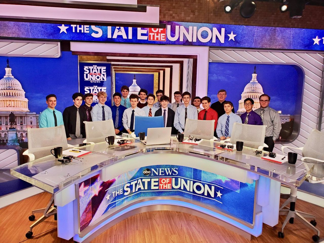Brother Paul Hannon, fourth from right, and members of WFBN-TV of Monsignor Farrell High School, are shown on the set of the ABC-TV newsroom. (Courtesy/Brother Paul Hannon)Staten Island Advance